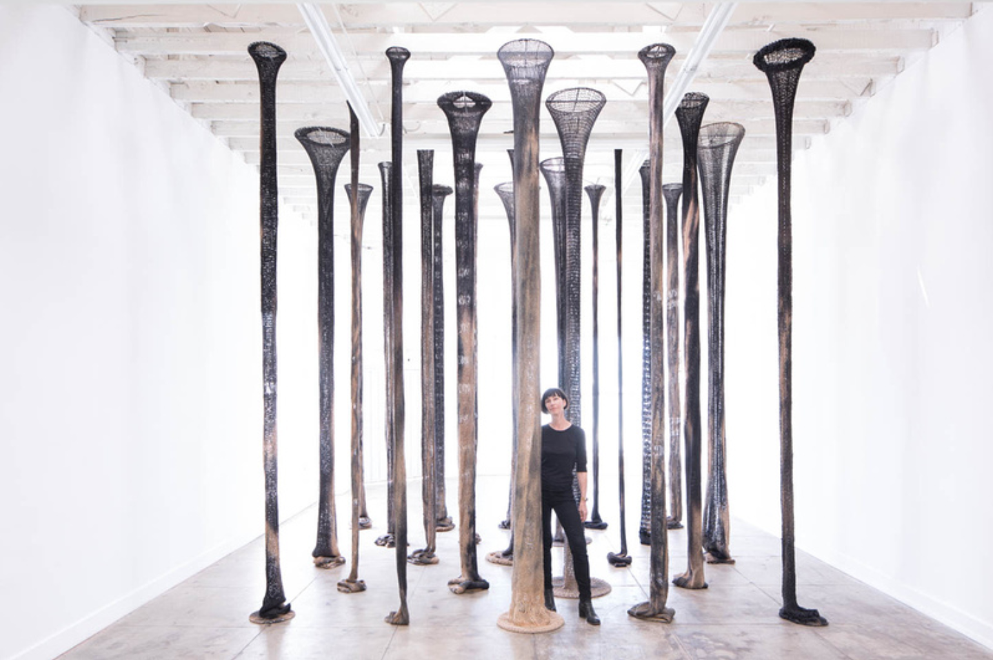 Claudia Parducci standing in her installation, 23 Columns